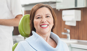 Lady sitting on dental chair smiling