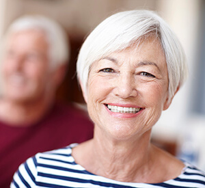 Elderly lady in striped shirt smiling