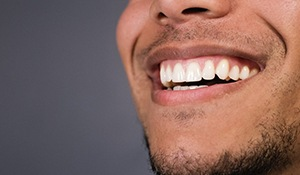 Man with healthy gums and teeth smiling