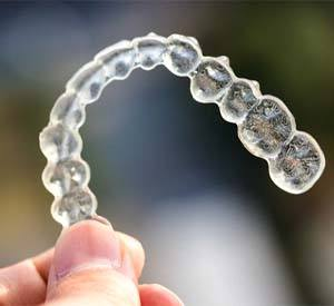 Young lady looking up to dentist smiling