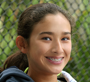 adolescent girl smiling with braces