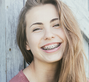 Young teen with braces smiling