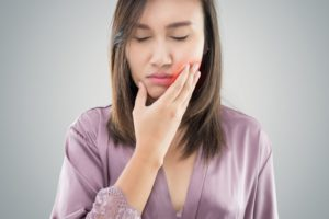 woman frowning from tooth pain