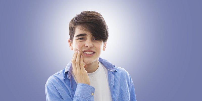 Teen with sore braces